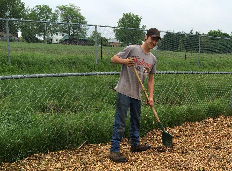 young guy shovelling.JPG