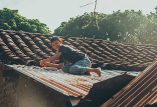 - ..Luis installing a solar panel provided by the Ometepe Sustainability Group, Nicaragua.