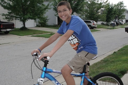 Corey Lane on his first mountain bike in July 2010. One of Corey's favorite activities was mountain biking. Corey passed away from Crohn's disease and Osteosarcoma on May 21, 2013. He will be forever remembered for making every day an adventure.