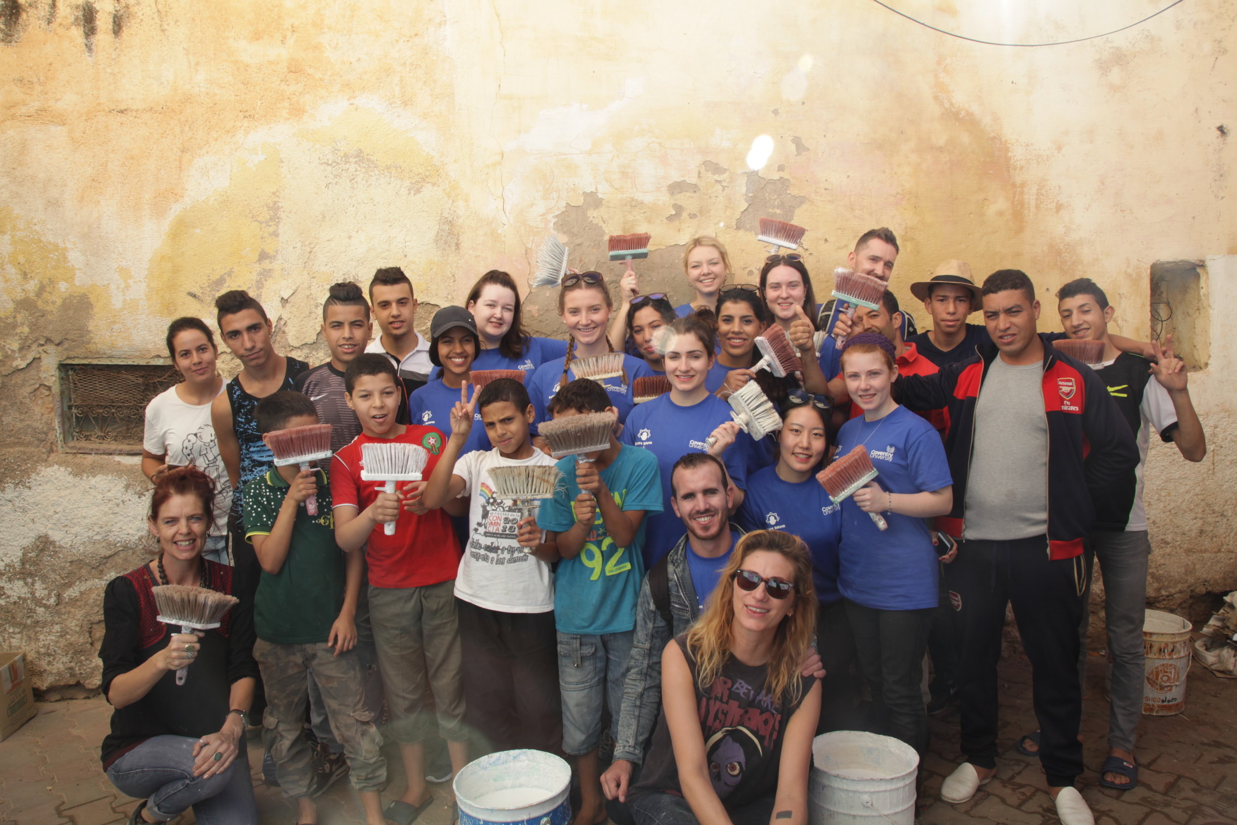 Painting the walls of Sefrou with Jess Stephens (Culture Vultures), Brendan StJohn, local residents of Sefrou and Coventry University students