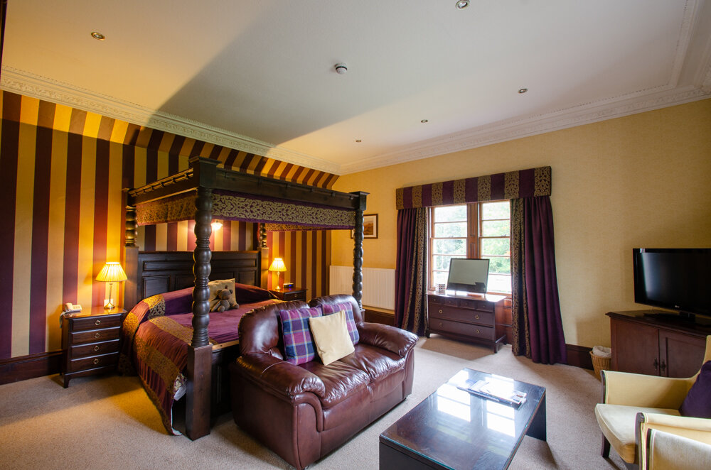 Grouse - The Grouse is our largest room and has a Super King sized four poster bed. It enjoys a dual aspect views over the gardens and river and offers two comfortable sitting areas.