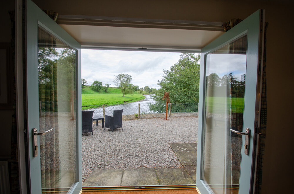 River Suite - With french doors leading to a patio overlooking the beautiful waters of the Nith, the River Suite offers all the space and seclusion you need to relax and enjoy your surroundings.