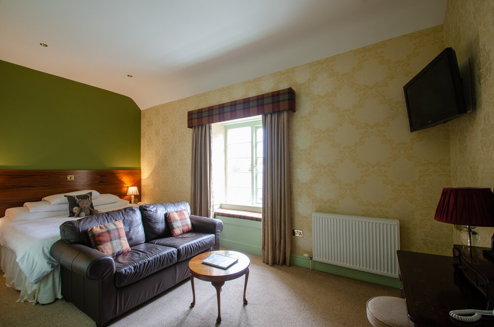 Partridge - The Partridge is a charming, contemporary room. It has a Super King sized bed, enjoys a view over the gardens and has a comfortable sitting area to relax.
