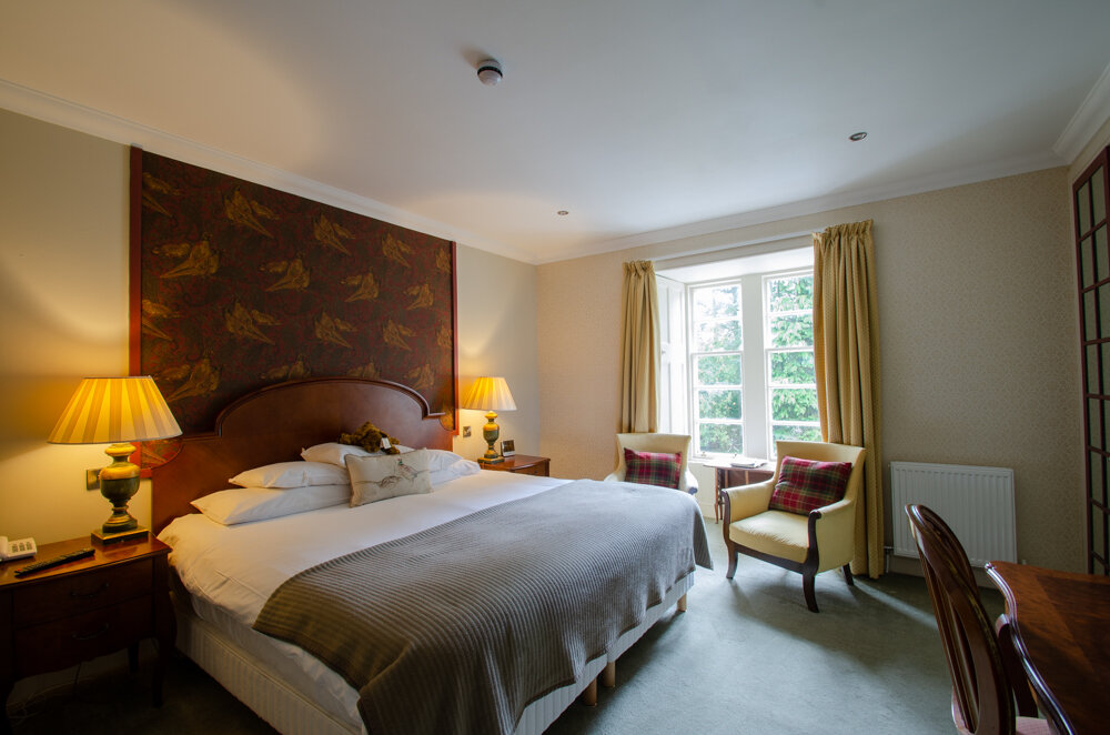 Pheasant - The Pheasant is a spacious, luxurious room in a traditional style. It has a Super King Size bed and a gorgeous view over the garden, down to the river beyond.