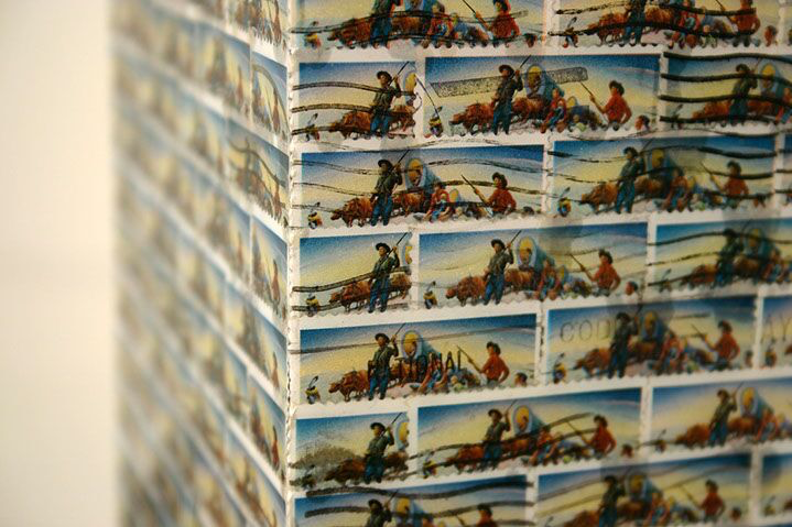 """Jordan Scott, """"Opening the West"""", detail, vintage stamps with resin on panel"""