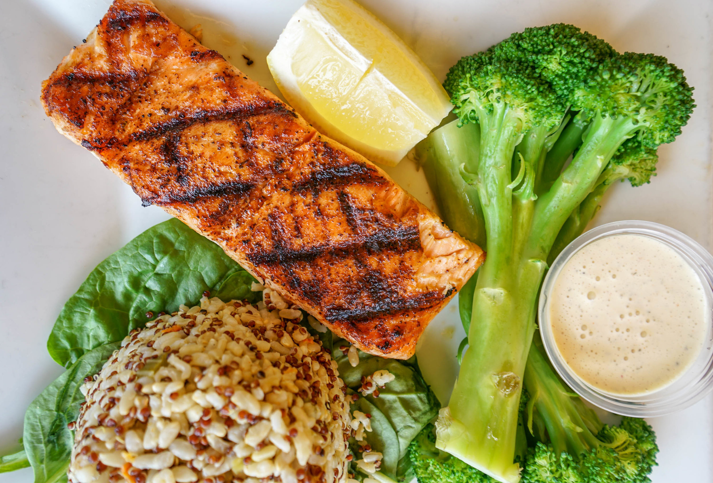 grilled salmon, fresh broccoli with quinoa rice