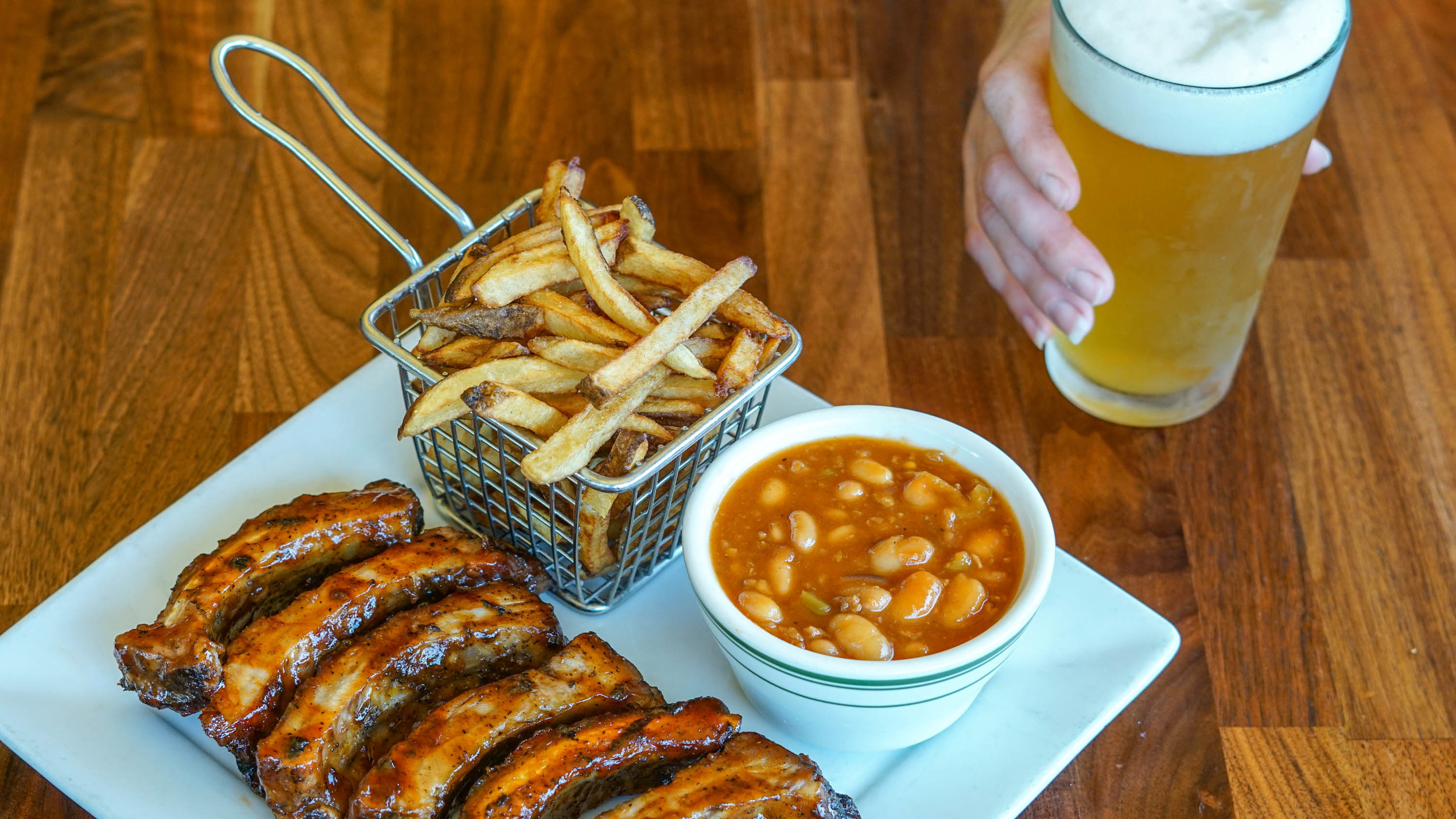 house smoked ribs, beans, fries, glass of beer