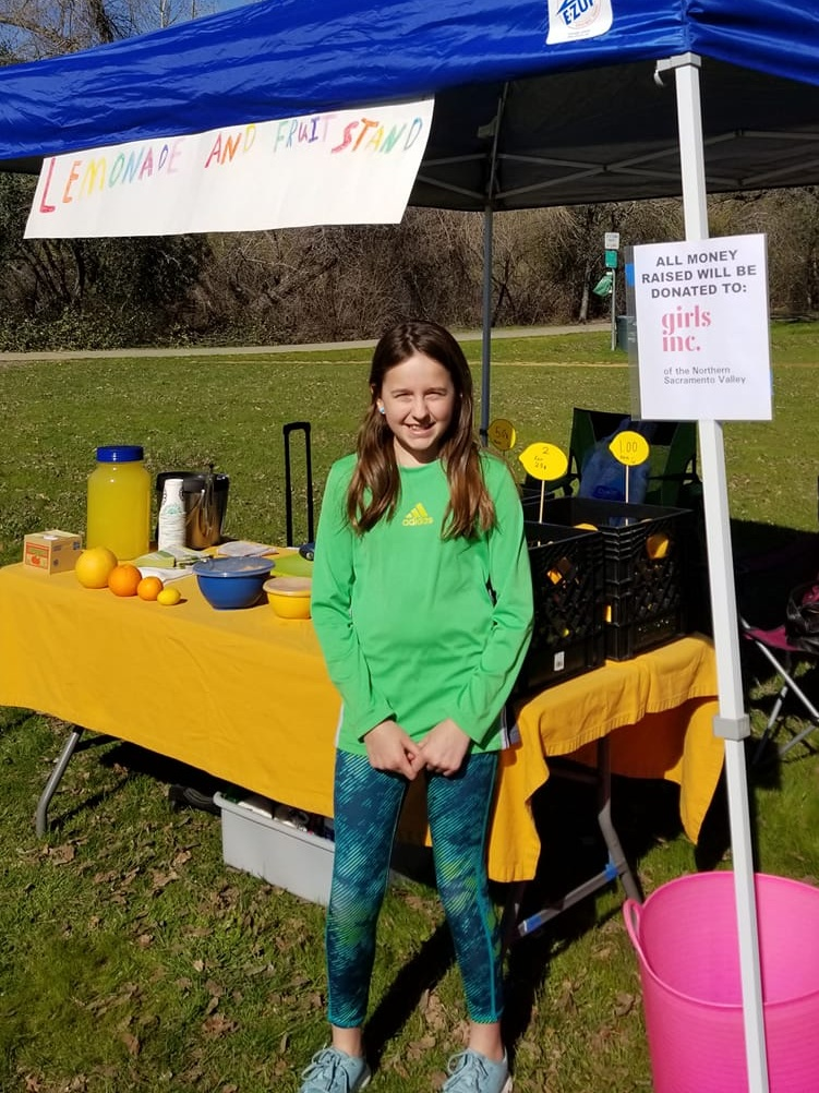 Local Girl Donates Fruit Stand Funds