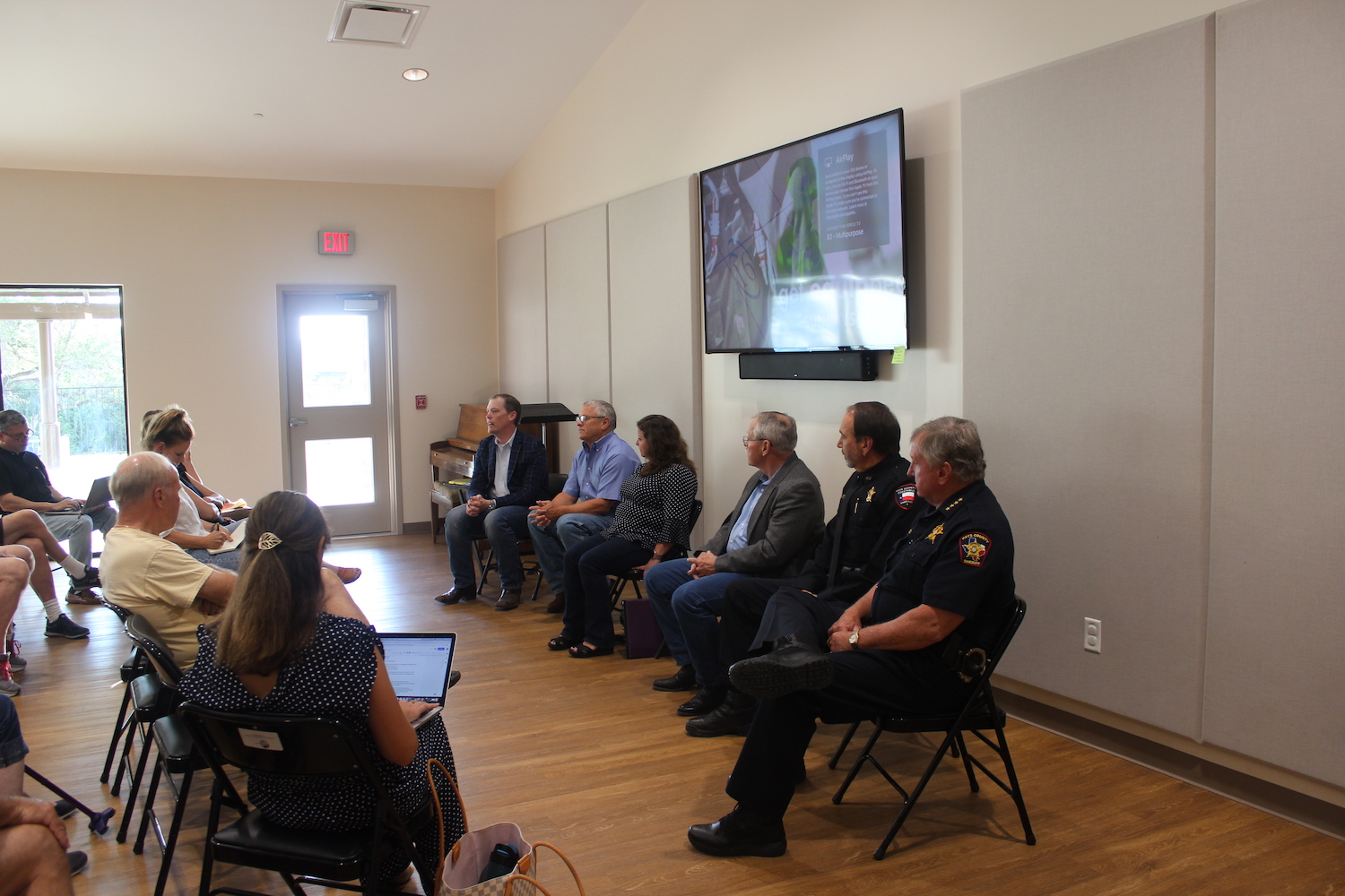 Community seeks answers to Hwy. 290 safety issues - Smith hosted a panel at Sunset Canyon Baptist Church on June 17 to discuss overall safety concerns on Hwy. 290. Panelists included Dripping Springs Mayor Pro Tem Bill Foulds, TxDOT Assistant Area Engineer Michelle Romage-Chambers, Hays County Precinct 4 Justice of the Peace John Burns, Precinct 4 Constable Ron Hood and Hays County Sheriff Gary Cutler. Numerous community members, including Sarah Kline, were also in attendance.