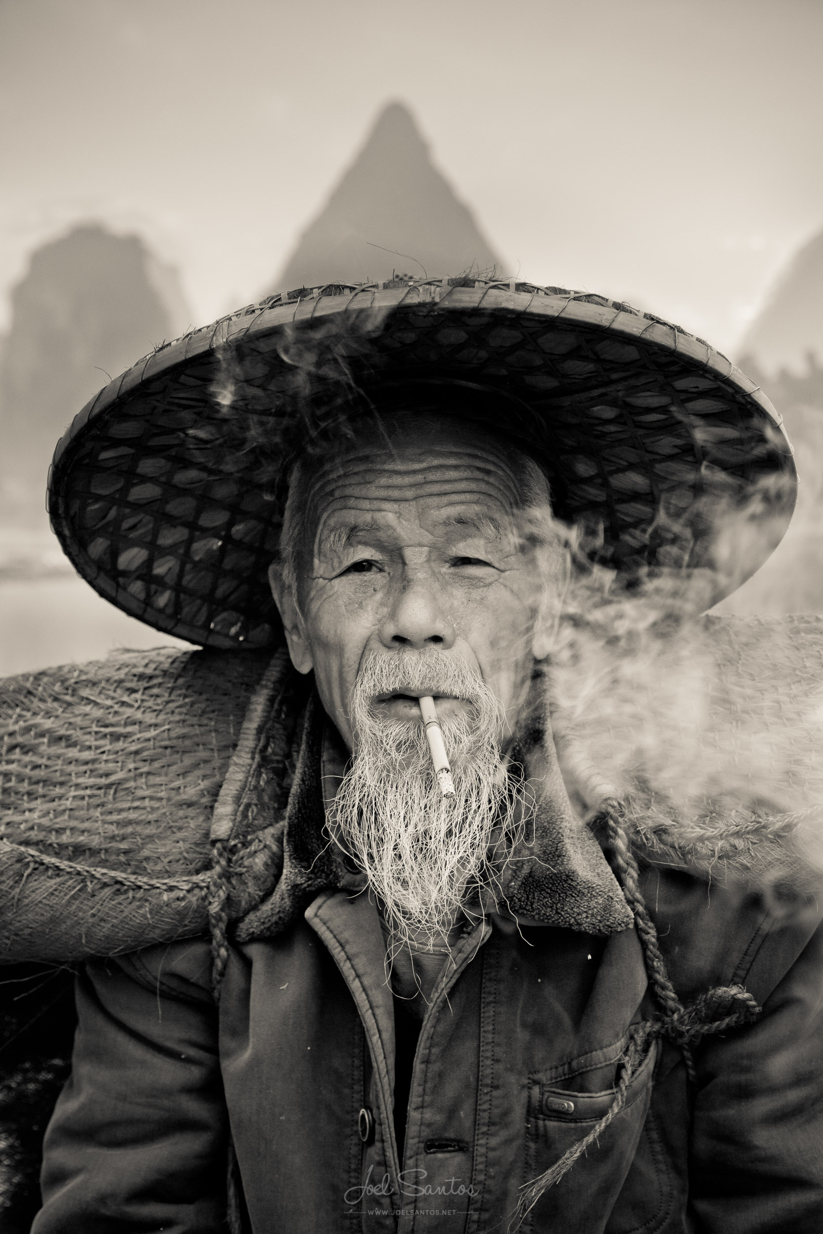 Cormorant Fisherman Smoking Cigar, Yangshuo, China