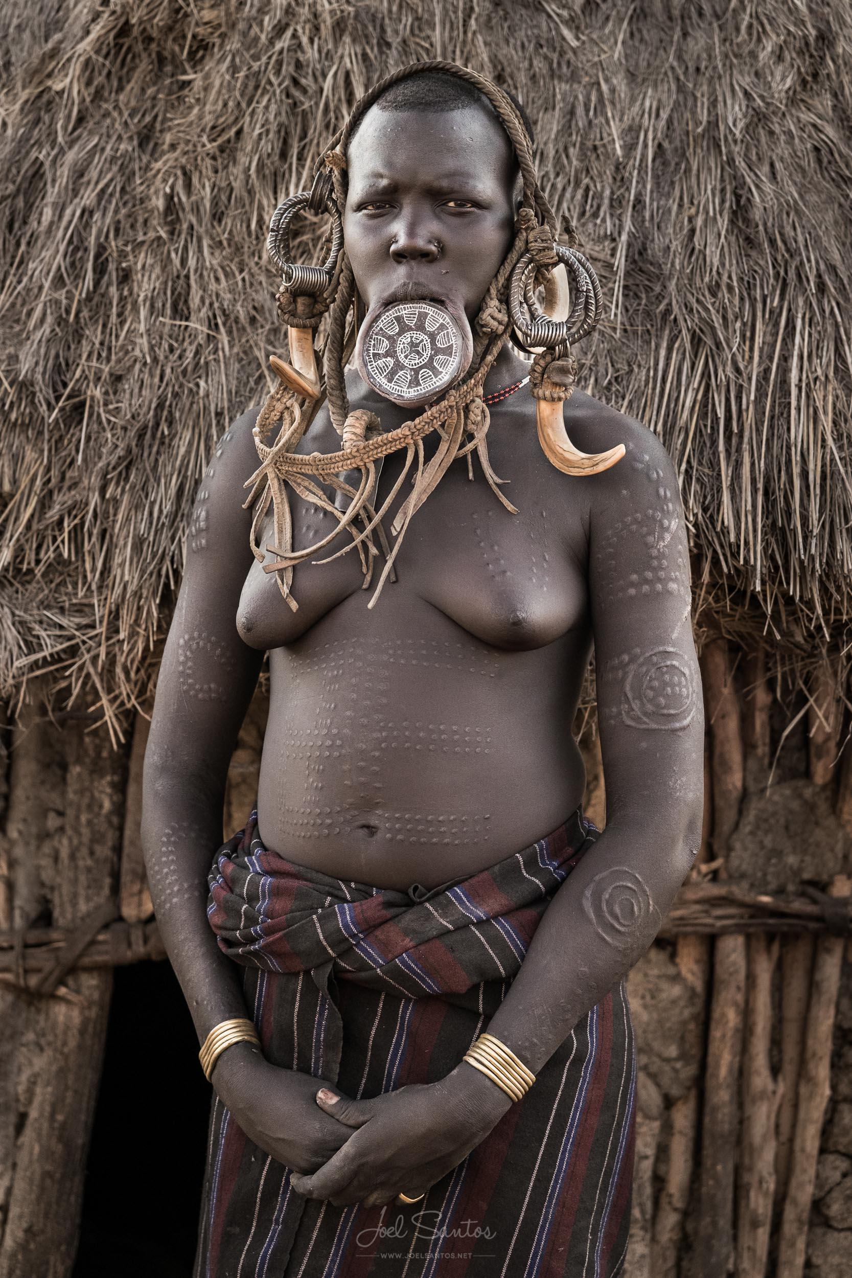 Mursi Tribe Woman with Ear Plates and Body Scarification, Omo Valley, Ethiopia