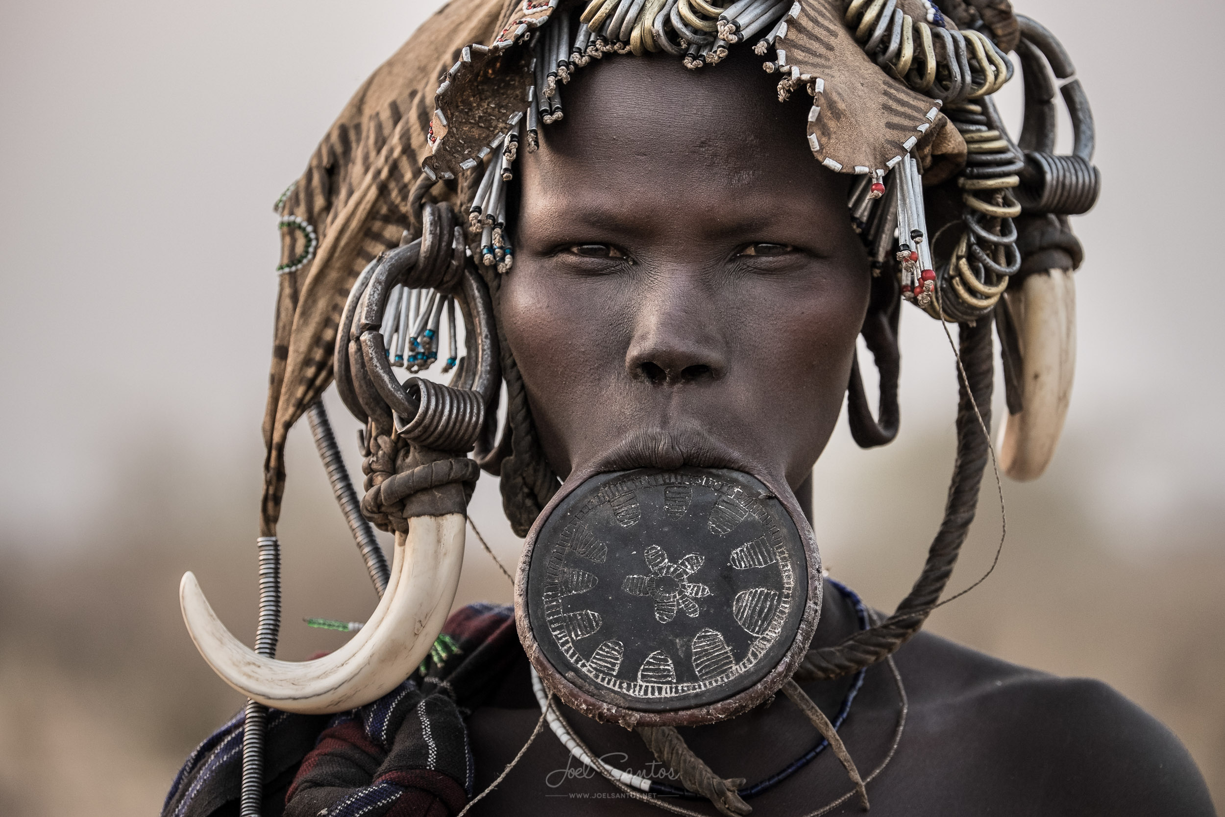 Mursi Tribe Woman with Lip Plate and Pig Fangs, Omo Valley, Ethiopia