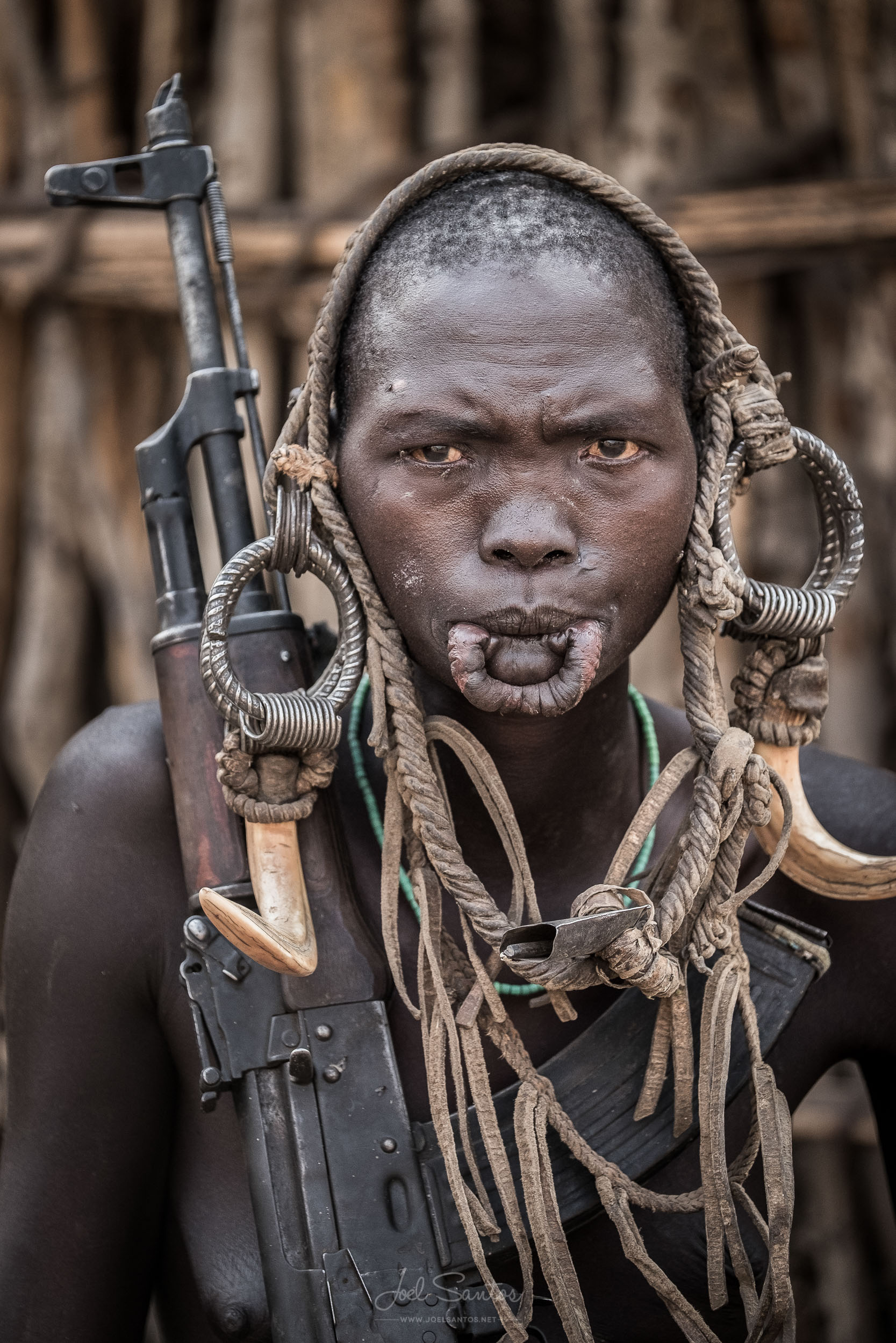 Mursi Tribe woman holding an assault rifle, Omo Valley, Ethiopi