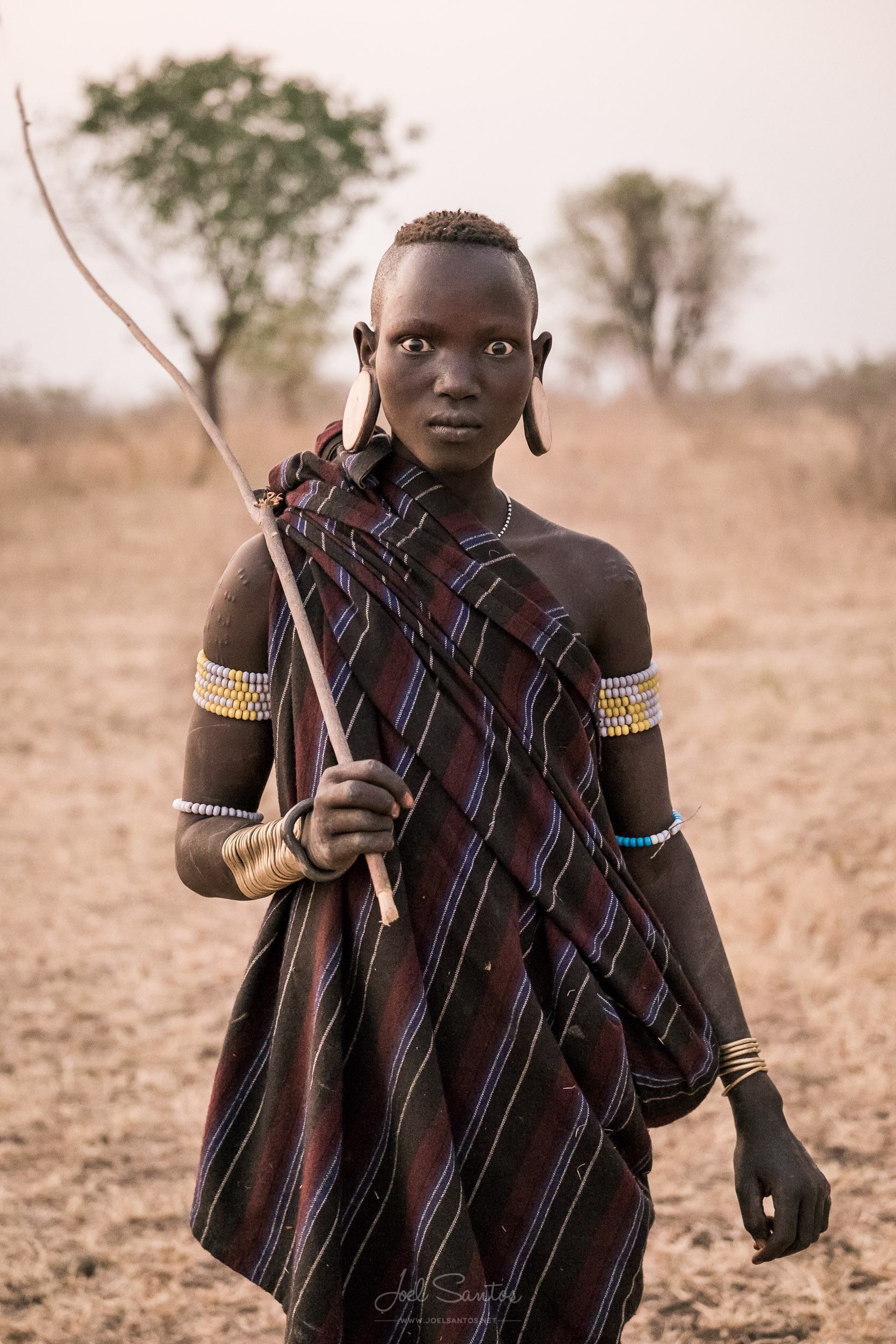 Mursi Tribe Woman holding a stick, Omo Valley, Ethiopia