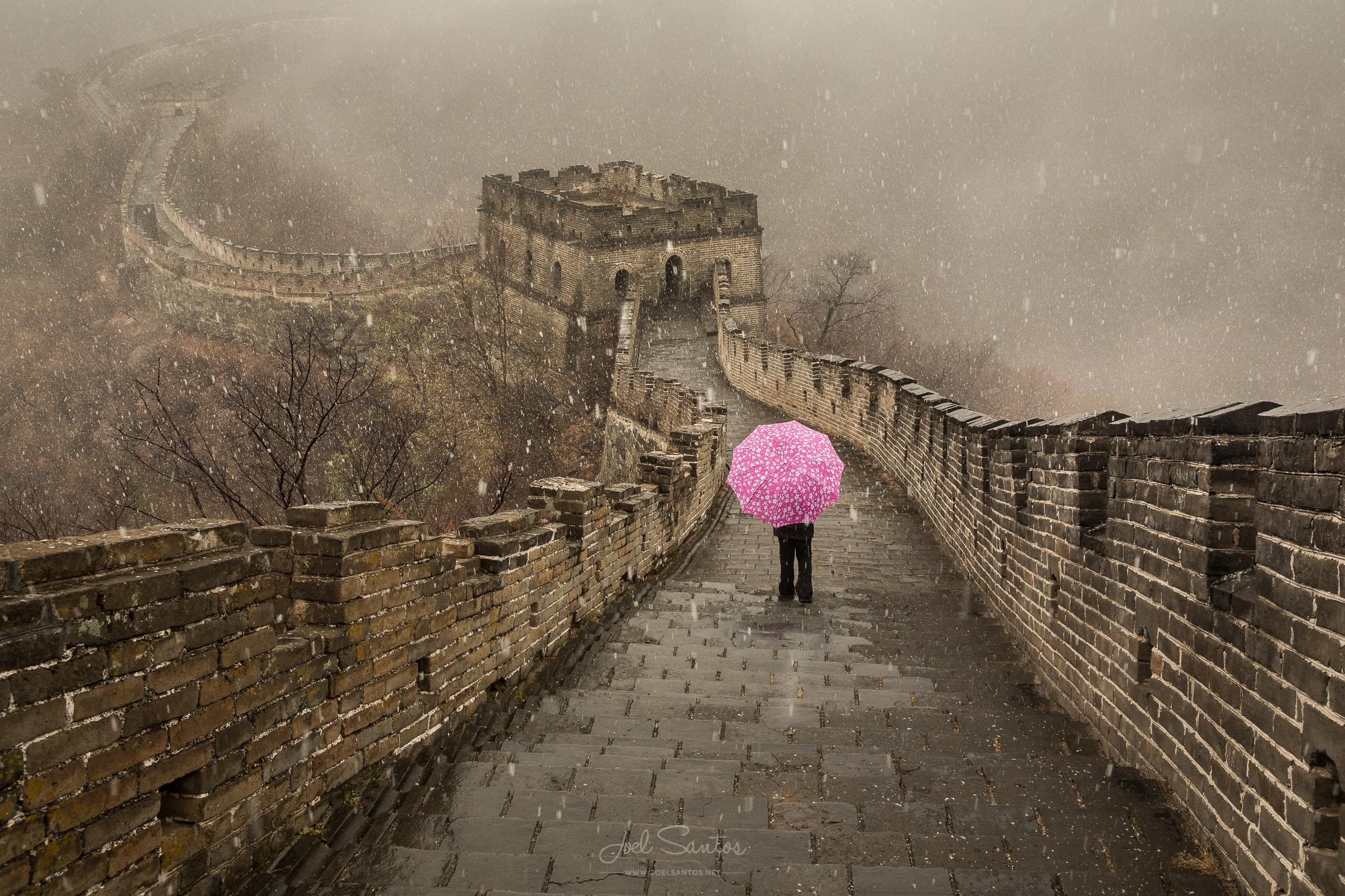 Woman with umbrella, Snow at Great Wall of China, China