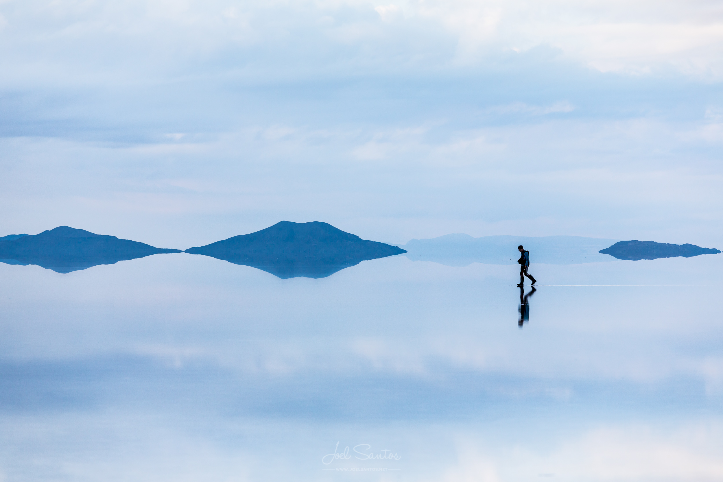 Man walking over reflection, Uyuni salt flats (Salar), Altiplano