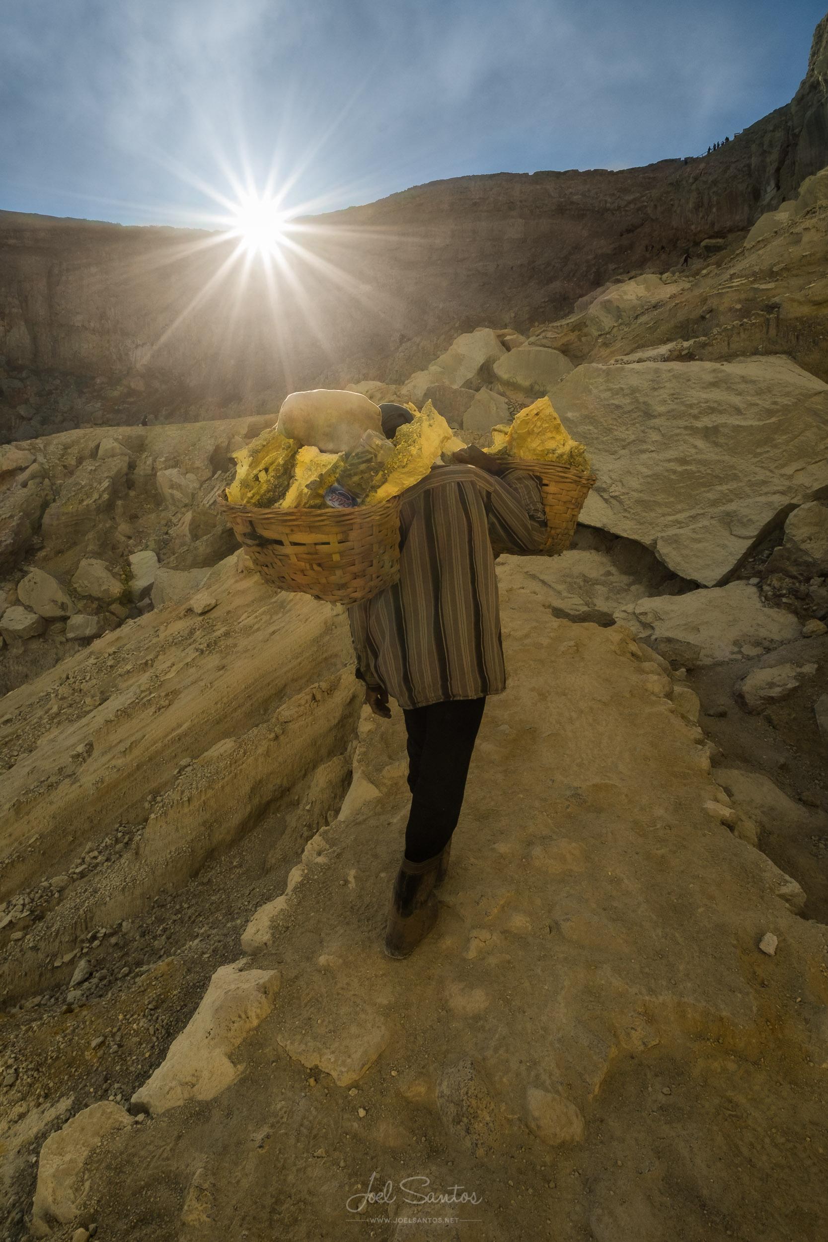 Miner carrying 80 kg of Sulphur, Kawah Ijen Volcano , Java islan