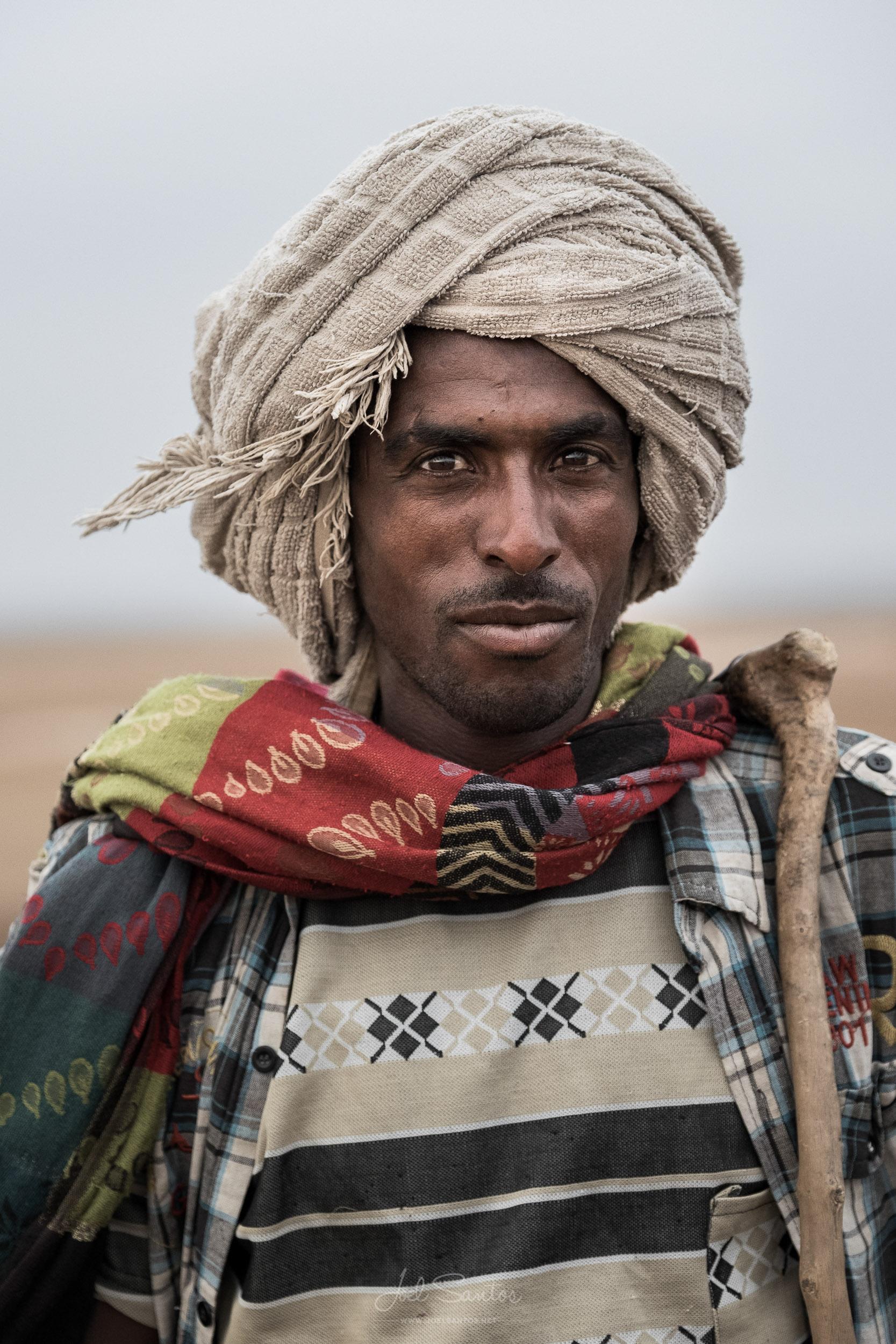 Salt Miner with dromedary caravan, Danakil Depression, Afar, Eth