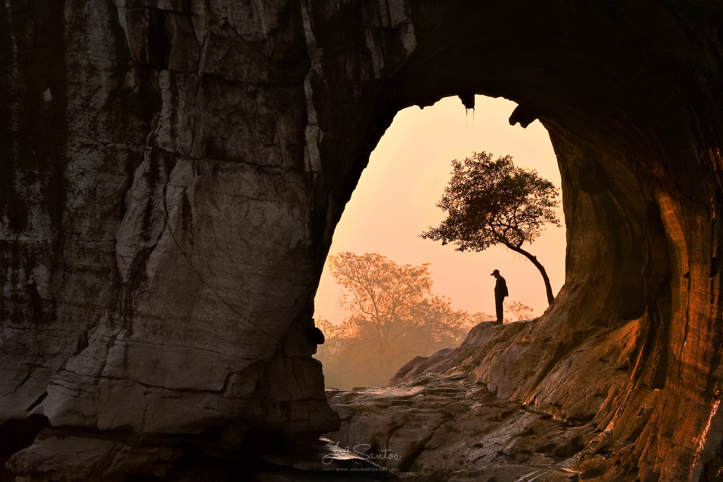 Man inside a cave, Elephant Trunk Hill, Guilin, China
