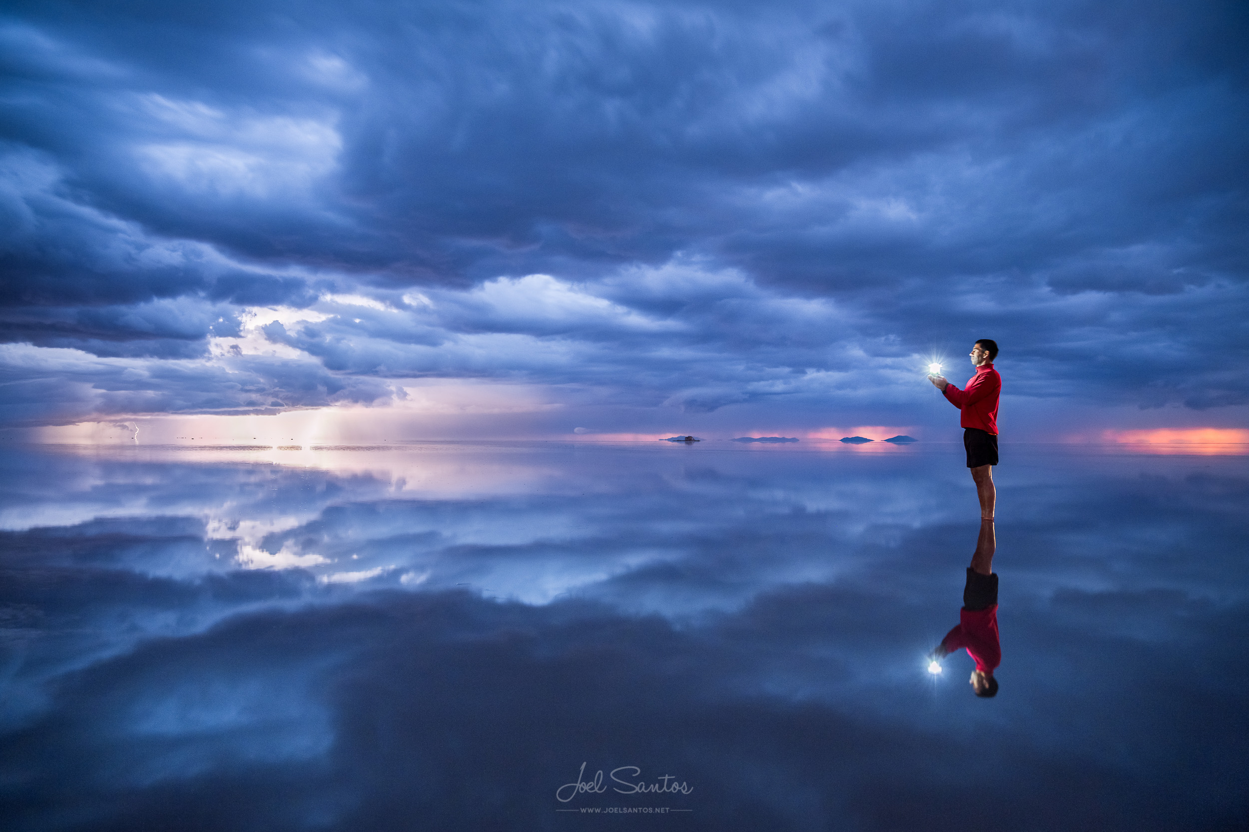 Storm and reflection, Uyuni salt flats (Salar), Altiplano, Boliv
