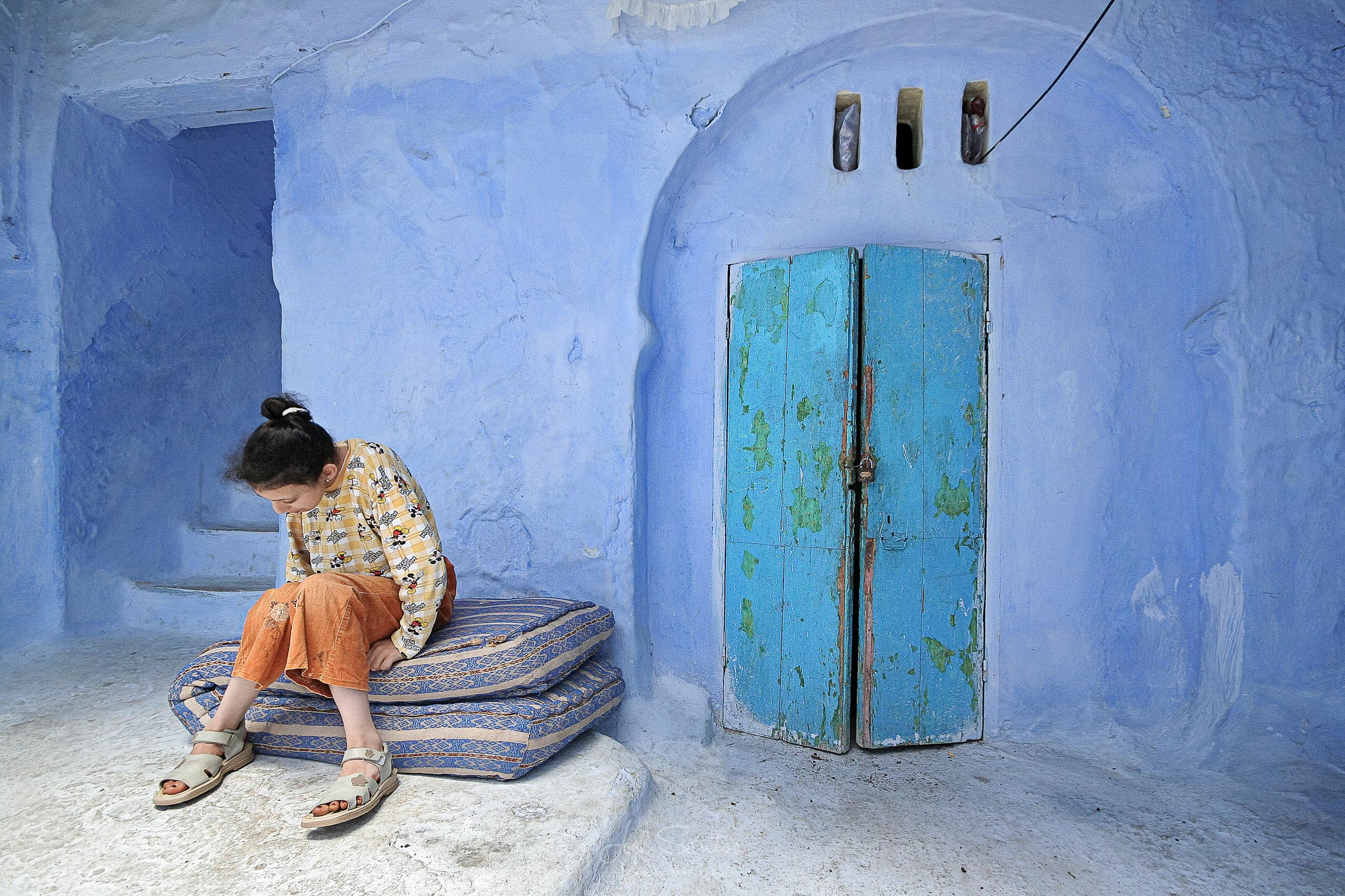 Girl insde patio, Chefchaouen, Blue city, Morocco