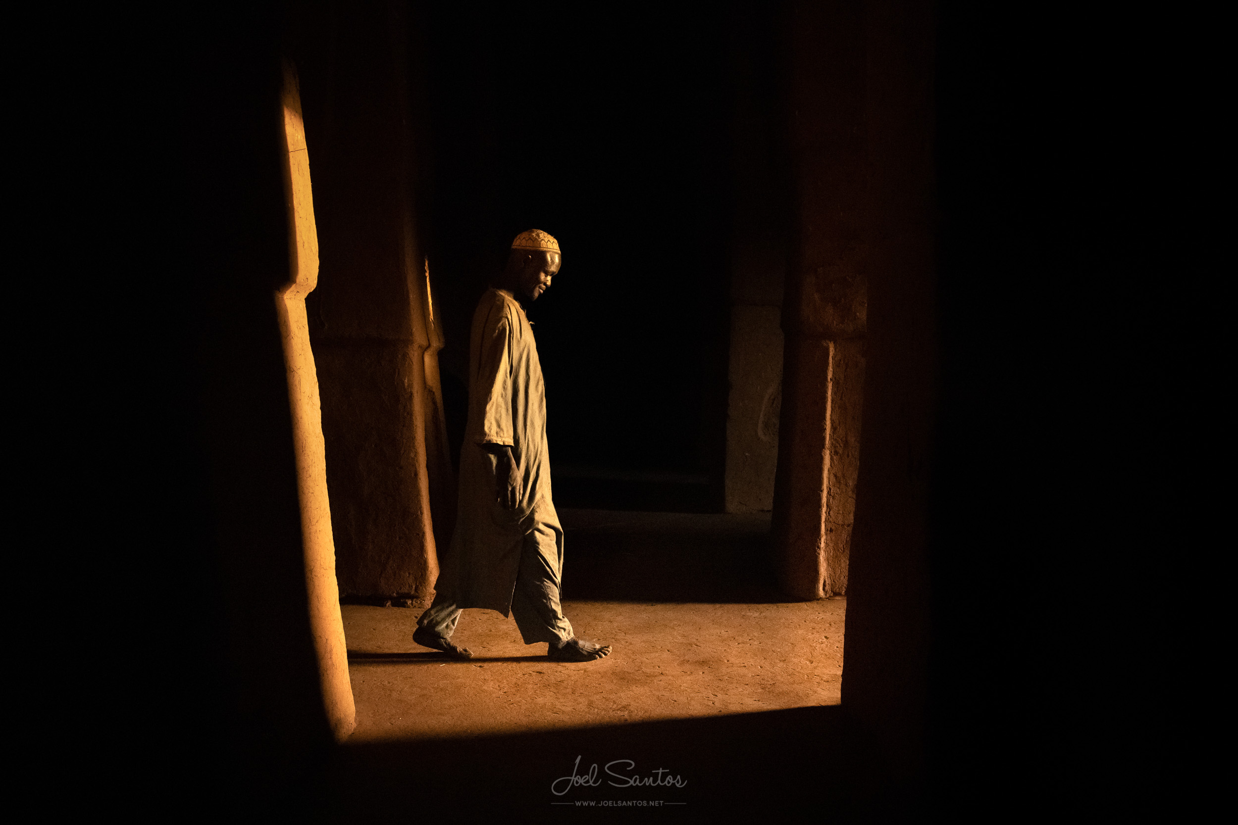 Man walking inside a Mosque, Niger