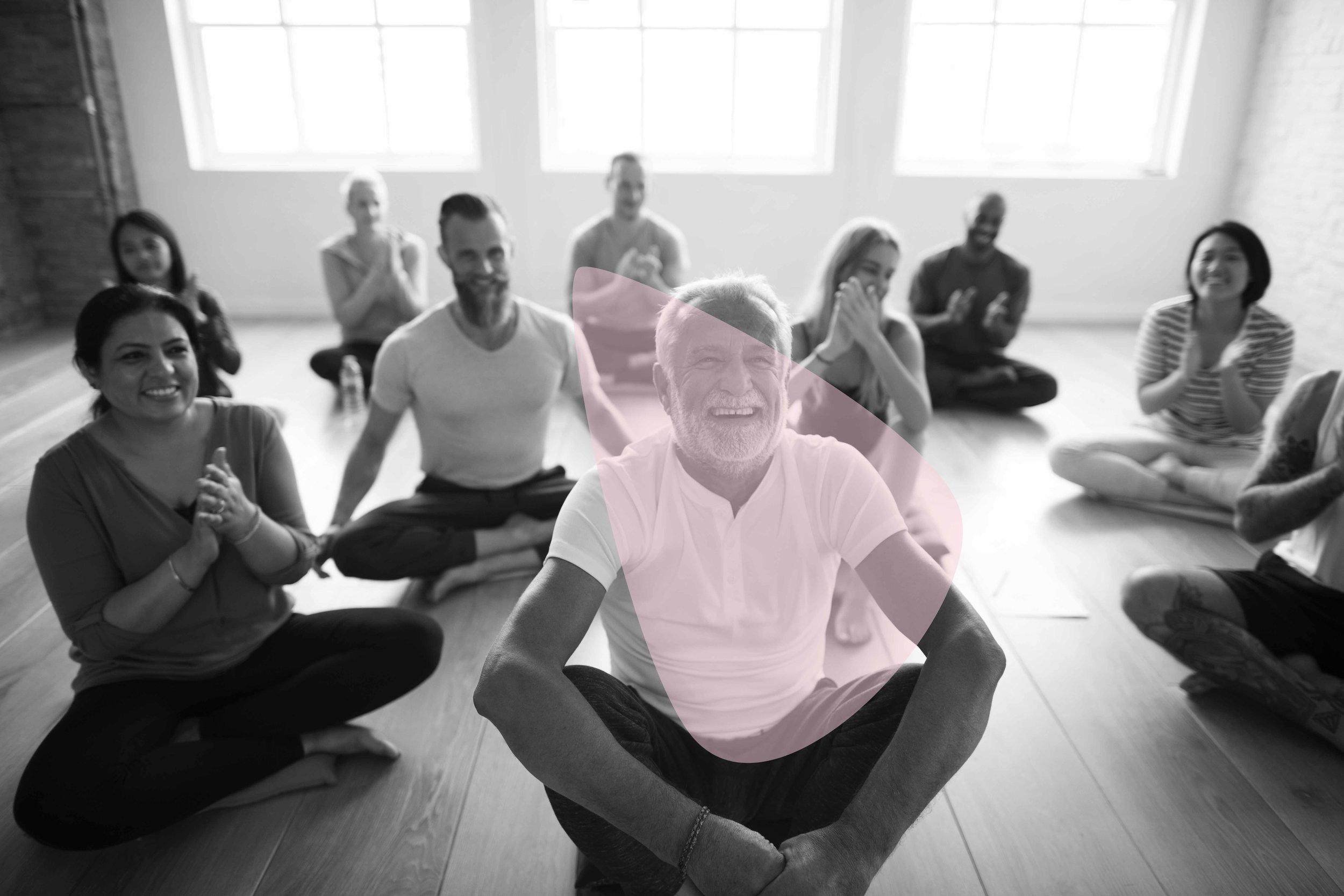 Mixed Yogis Having Fun at a Yoga Class