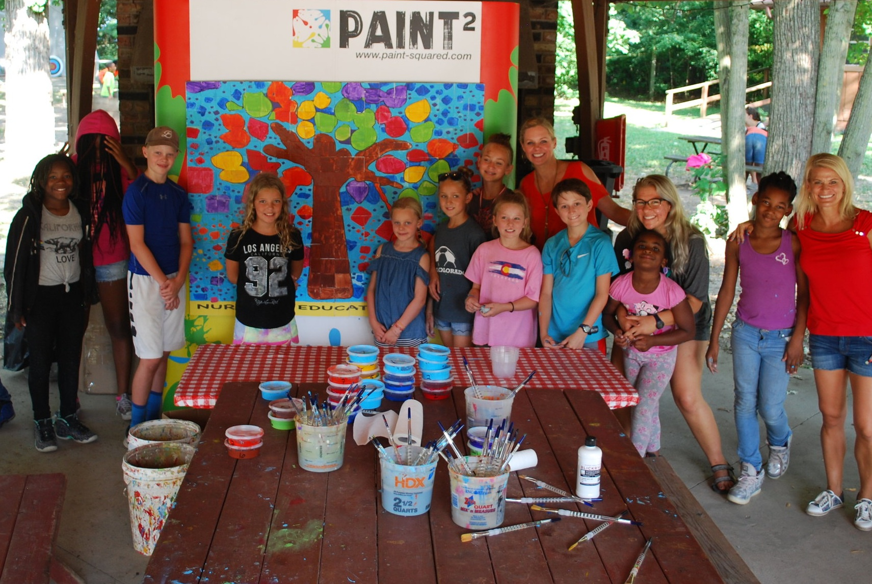 2019 Invitation Inspiration - Volunteers and campers painted tiles with enthusiasm and pride to create a one of a kind mural that will be permanently installed at House in the Wood Camp for generations to see.