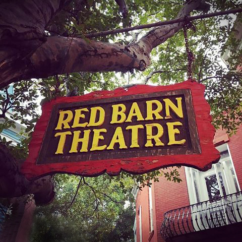 this hand-painted red barn theatre sign still hangs from the tree out front of the main theater entrance.
