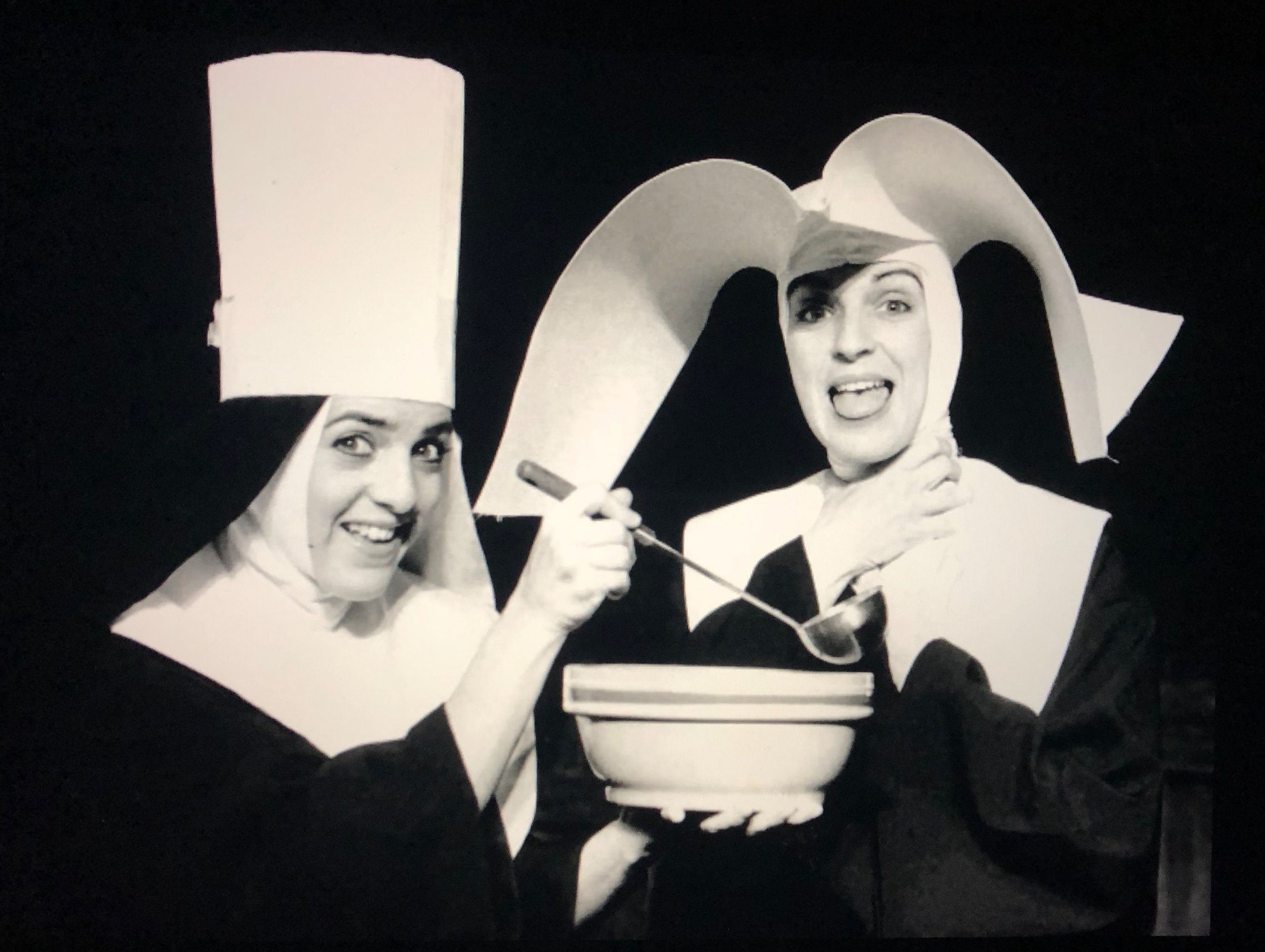 dancer and singer, penny leto, and red barn theatre co-founder, mimi mcdonald stand dressed as nuns from an early red barn production