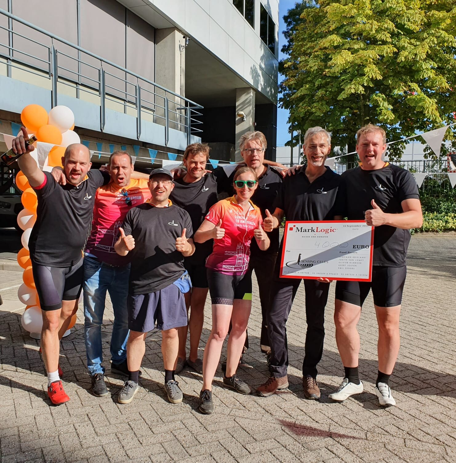 The Dutch MarkLogic team handing over the check to Jan Kees Schakel and Hugo Koopmans of Sensing Clues Foundation