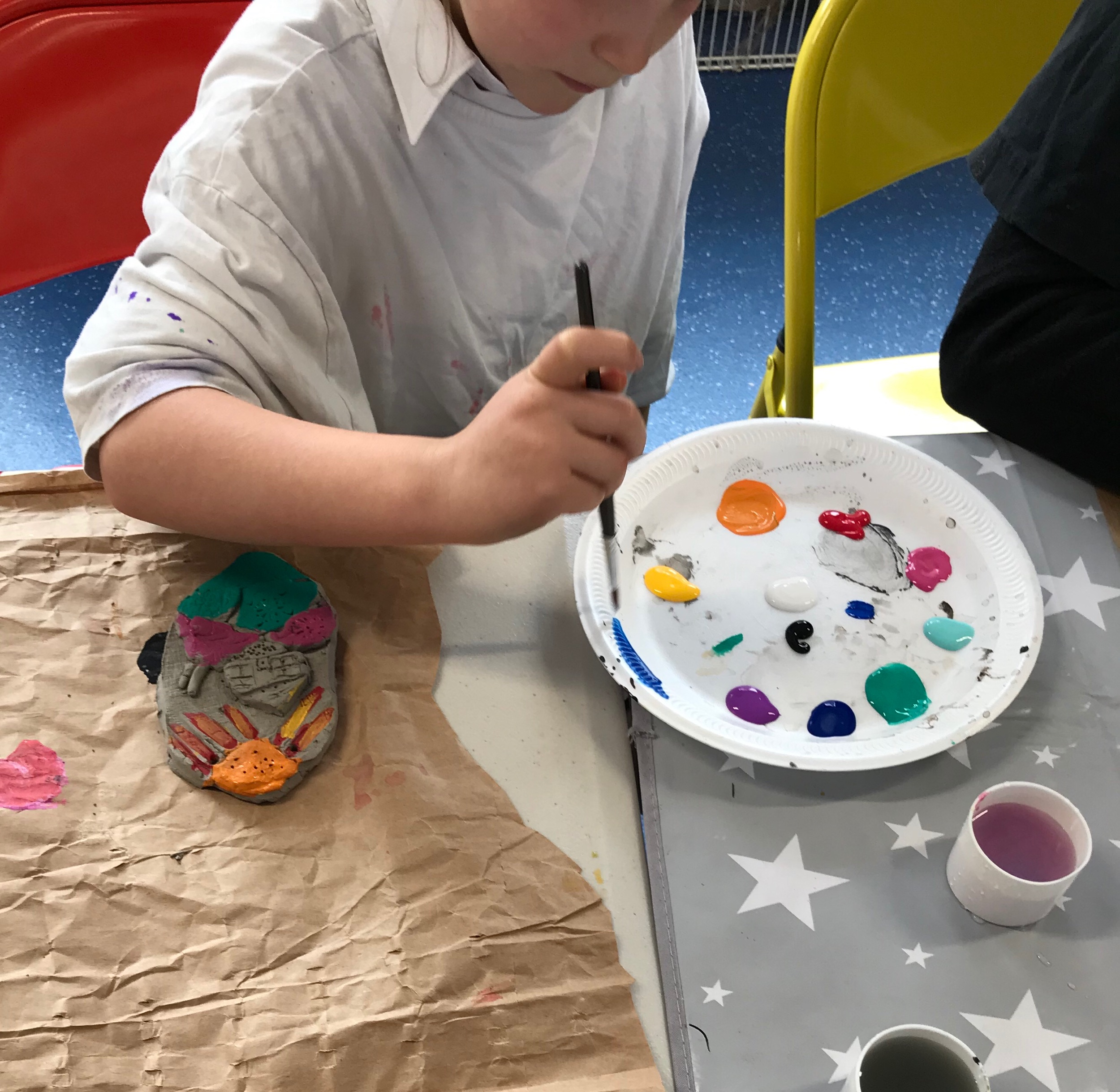 Painting with acrylics onto clay landscapes