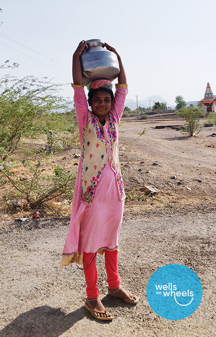 A 10 year old facing adversity with a smile in the village of Dahiwad, India
