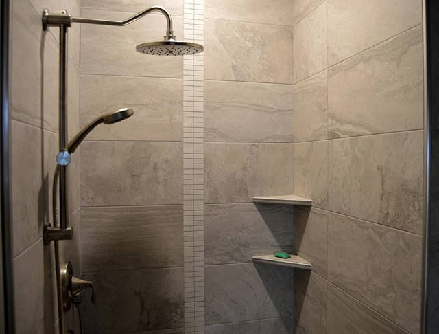 A vertical accent element in your new shower is a great way to add presence and stylistic interest within the tile design and layout.