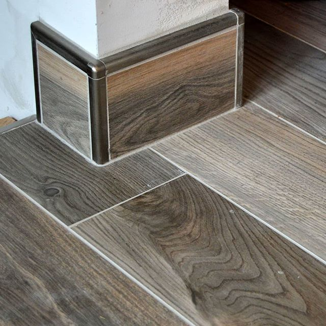 Tile base is one of my favorite ways to finish off a floor installation. - It can provide total water containment for bathrooms and other wet areas. Guaranteeing water spills won't sleep under your baseboard and cause further damage. It creates a total bond from your floor to wall, leaving no space for bugs or mice to enter into your home. Aside from the functional aspects it adds a luxurious finish to your space that can be customized to suit your tastes.