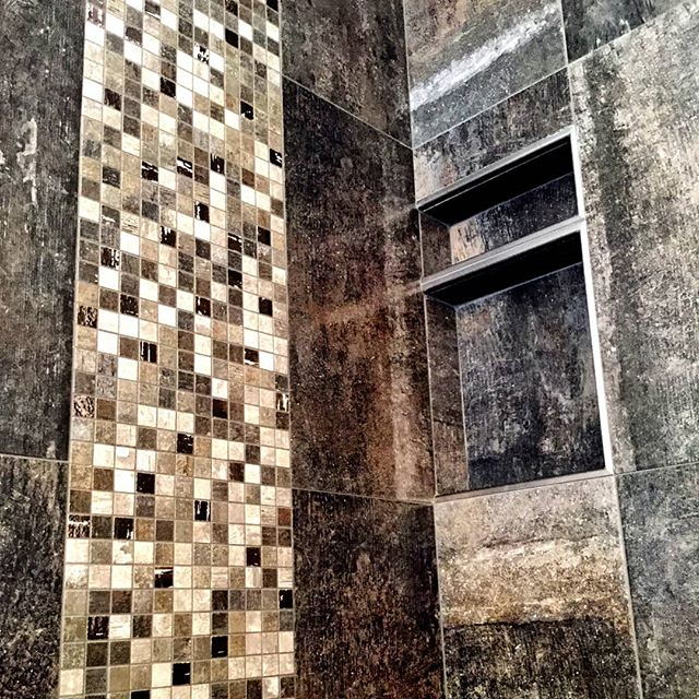 A tiled wall niche (ressessed shelf) is fun custom element you can add to your shower design.