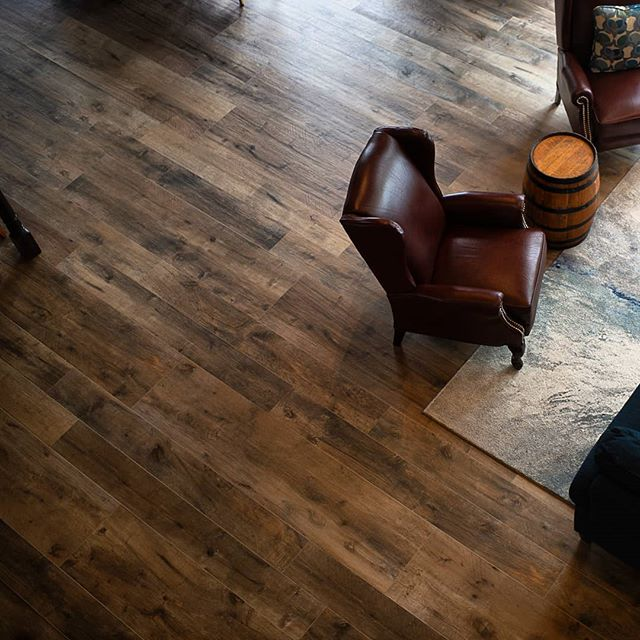 2300 sq/ft main floor tiled with large plank wood style porcelain.