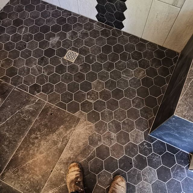 Having some fun scribing this hex tile into the larger field tile creating a spilling effect out of the shower entrance.