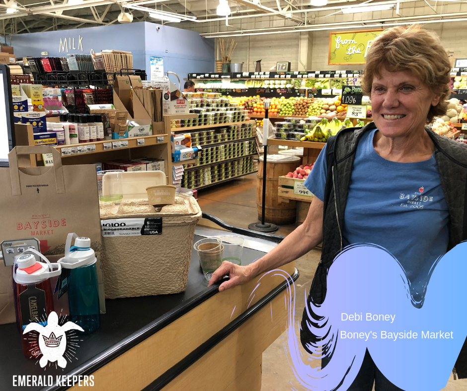 "Debi Boney is with many of her ""green"" items for sale. Boney's is working to reduce single use plastics. They recycle, save food waste for composting, and have found alternatives to plastic. Getting rid of plastic water bottles will qualify Boney's a fully Emerald Green, Ocean Blue!"