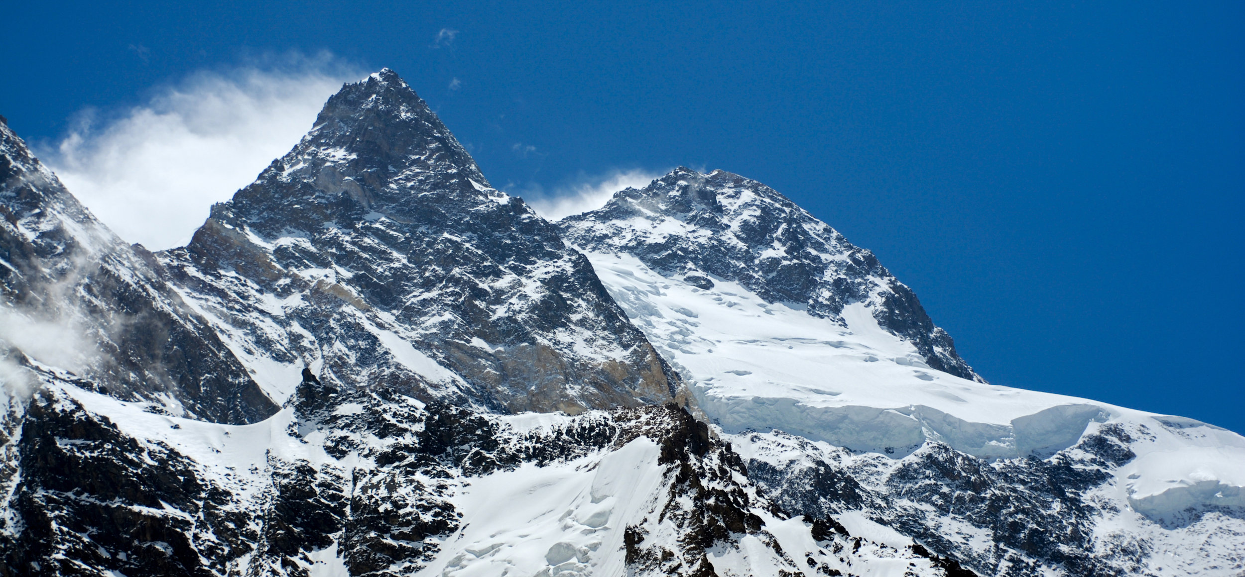 Broad Peak (highest point on right) viewed from the Gilkey memorial near K2 basecamp. Courtesy Dave Ohlson.