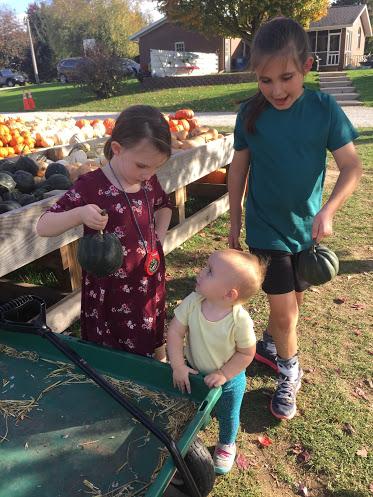 Nieces Choosing Pumpkins.jpg