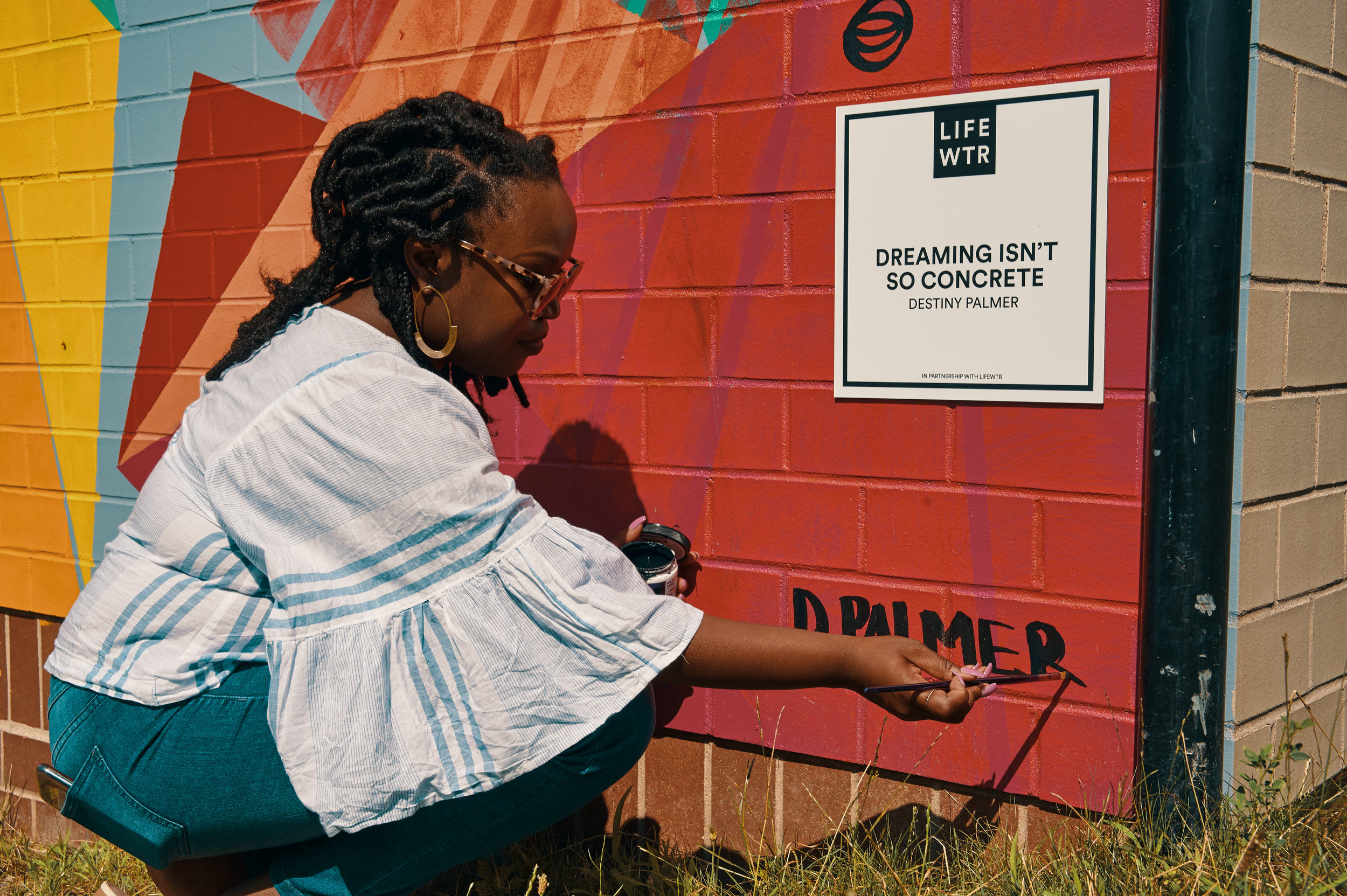 Destiny putting the finishing touches on her mural.