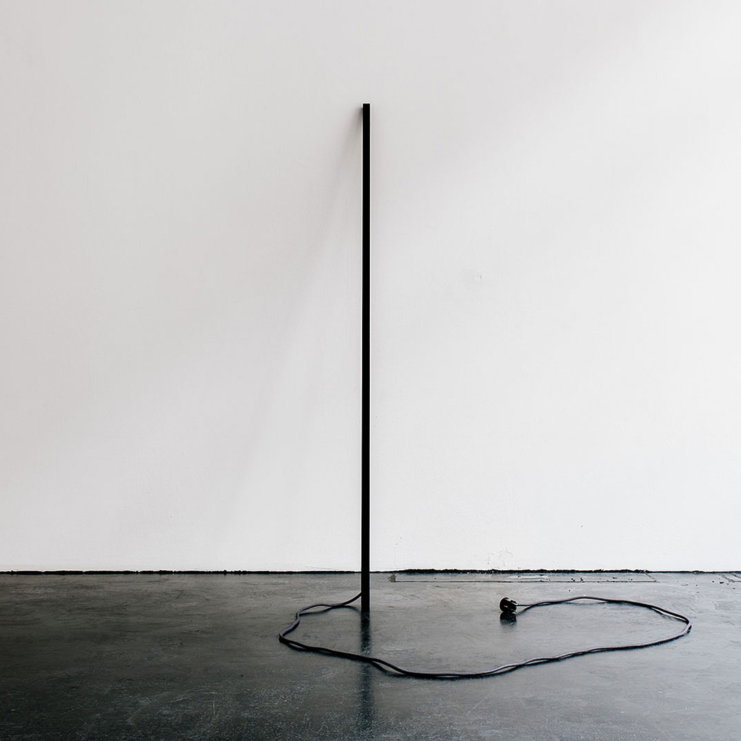 L1 - L1 was the first lamp we created. Hence the name.The form of the L1 floor lamp is guided by clear geometry and reduction to the essential – the lamp itself is no more than an accentuated stroke that leans lightly against the wall. Depending on the angle and orientation of the lamp, the range of illumination and shadow will vary. L1 is minimal down to the interaction – instead of using a switch, the lamp can be turned on and off with a single touch on any part of its surface, with a satisfying click sound.All electronics are accommodated inside the lamp itself, reducing power supply to a minimum and integrating the cable into the sculptural appearance.
