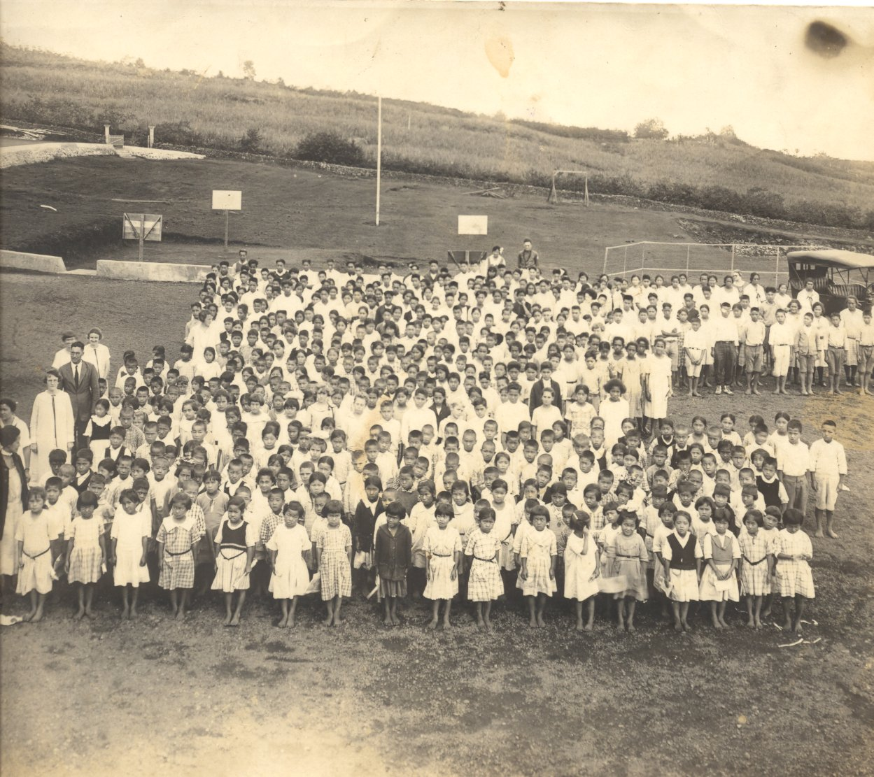 School children with teachers on play field c. 1930's. Photo donated by Paul F. Hirokawa, KonawaenaHigh School graduate, Class of 1944. From the Collections of Kona Historical Society.