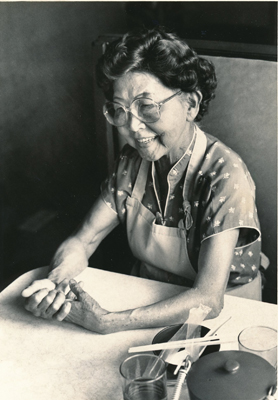 Photo of Mary Teshima by Bob Fewell: January 25, 1987 in Teshima's Restaurant. From the Collections of Kona Historical Society.
