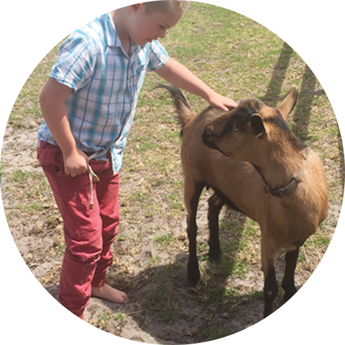 Ike barefoot with Nuzzle, the Goat -