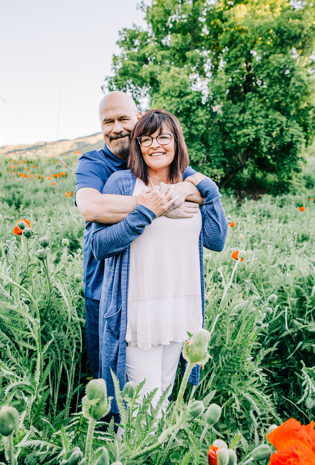 Professional family pictures to remember the special moments by Bella Alder Photography. These were taken in the Mantua, Utah poppy fields at the beginning of the summer as these red flowers were just starting to bloom! #bellaalderphoto #familyphotog #familyphotography #familypictures #familyphotos #outfitinspo #familyoutfits #poppyfields #northernutahfamilyphotographer #utahfamilyphotographer #cachevalleyfamilyphotographer