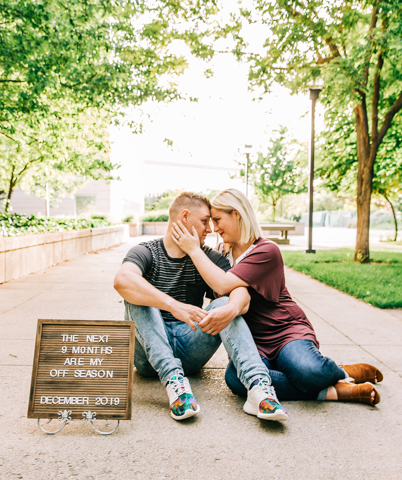 Pregnancy announcement using brown letter board urban setting young parents logan utah birth photographer bella alder photography #bellaalderphoto #newborns #newbornpics #newbornphotographer #maternityphotos #pregnancyannouncement #genderreveal #birthannouncement #birthstoryphotographer
