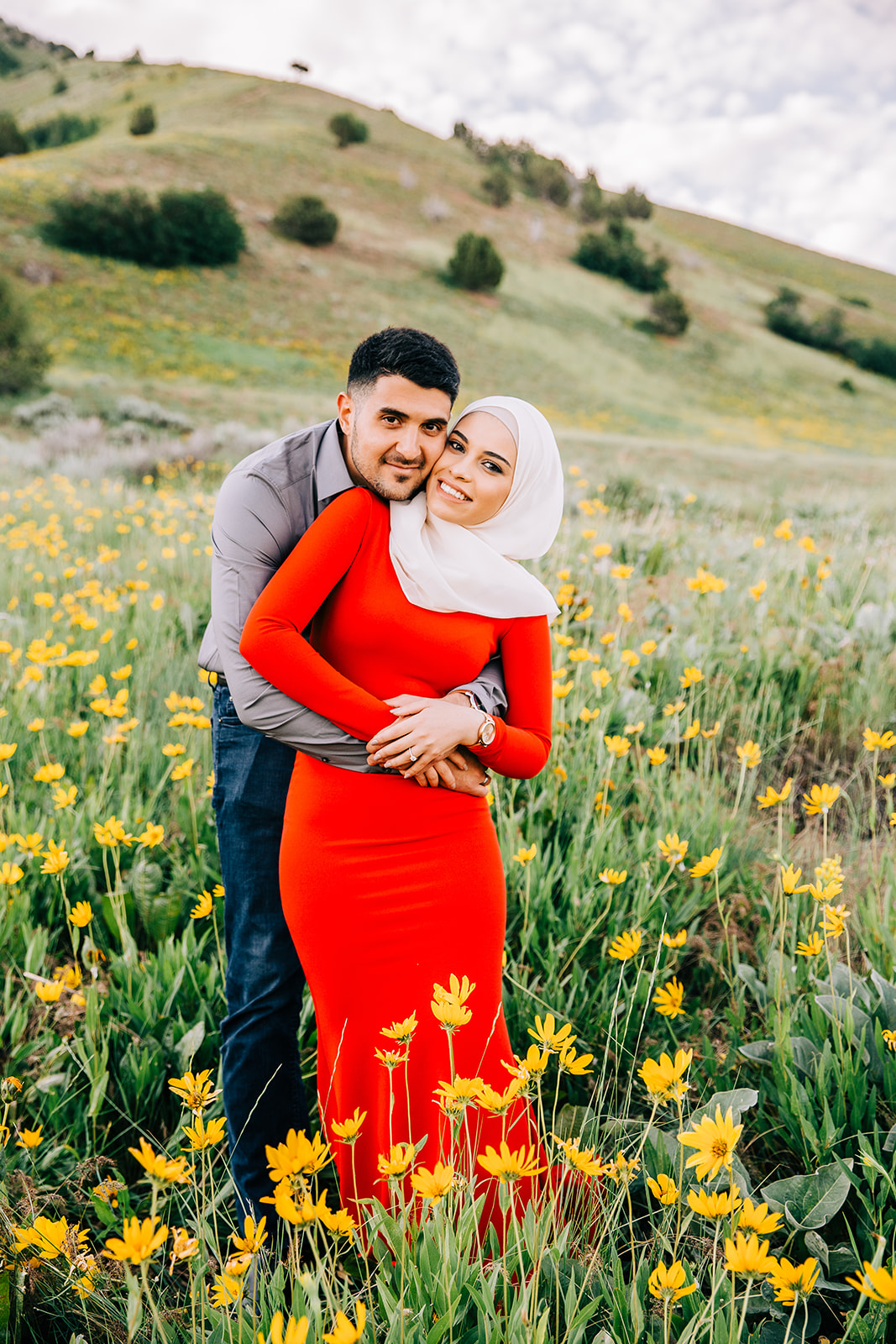 Professional engagement pictures in a beautiful field of yellow wildflowers in the rolling hills of north logan utah by bella alder photography couples photographer in cache valley #bellaalderphoto #engagements #utahengagements #engagementphotographer #engagementphotography #loganutahengagementphotographer #utahengagements #utahengagementphotographer #mountains #mountainengagements #weddingplanning #utahwedding