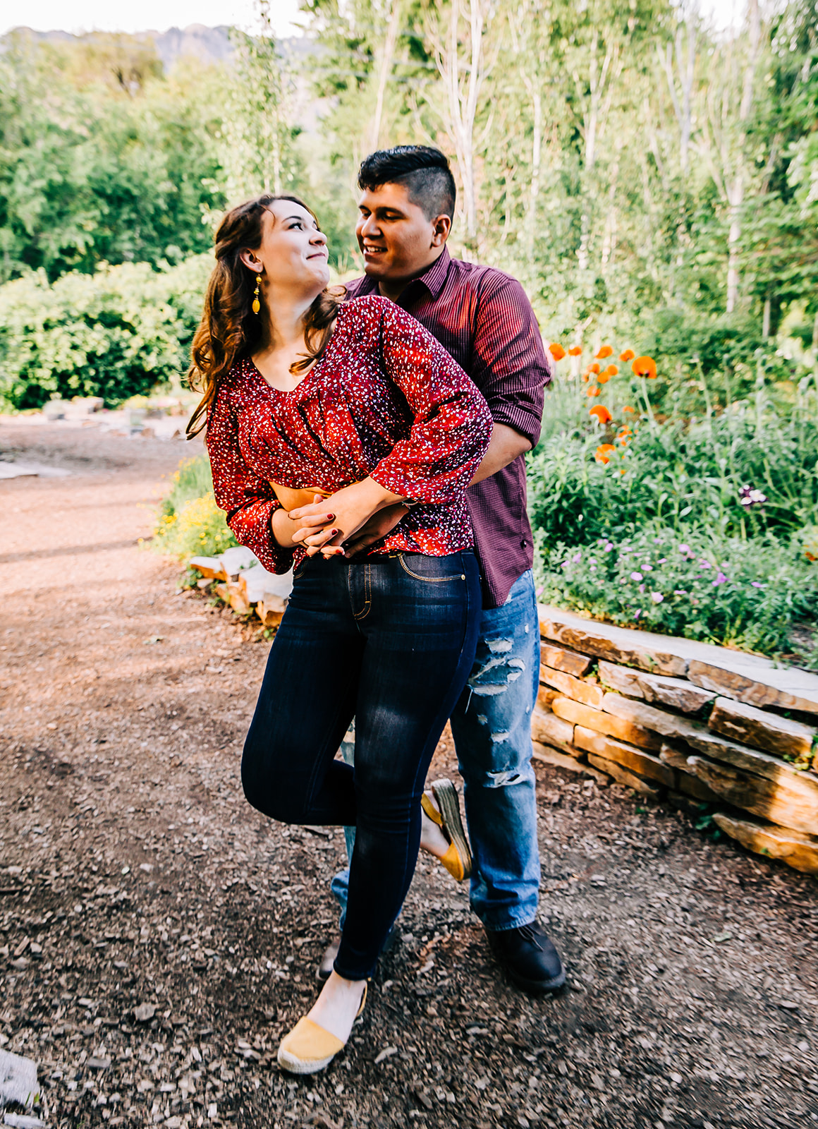 Couple during family pictures young married family members ogden botanical gardens family photos by bella alder photography in northern utah #bellaalderphoto #familypictures #outfitinspo #familyphotographer #ogdenutahfamilyphotographer #utahfamilyphotos #familyphotos #ogdenutah #botanicalgardens